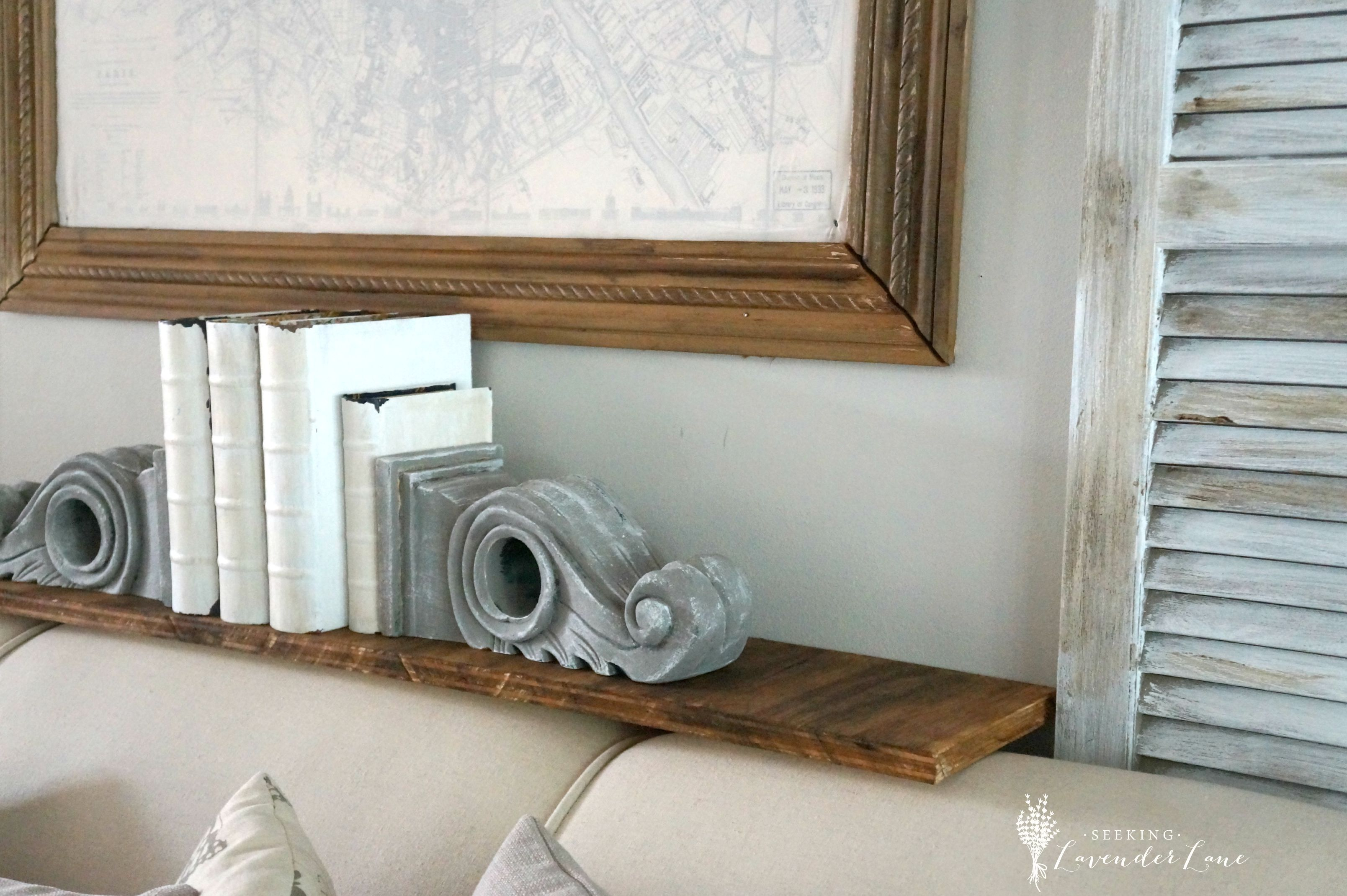 Rustic Shelf And Shutters Above Couch With Wall Shutters