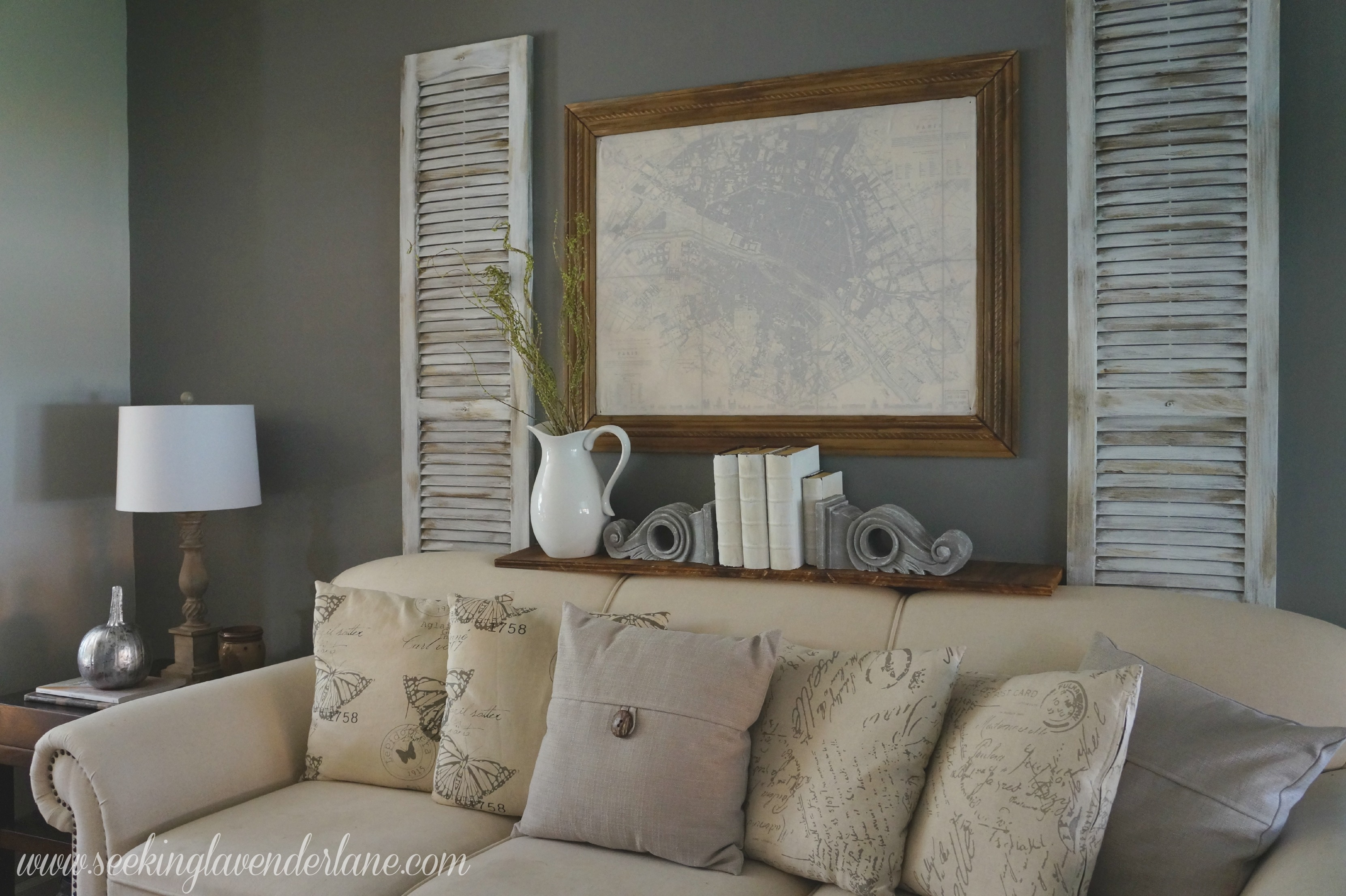Dark gray accent wall seeking lavendar lane for Living room decorating ideas with grey walls