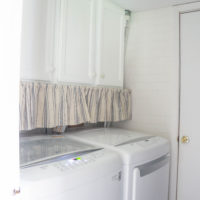 How to Hide Ugly Laundry Room Pipes