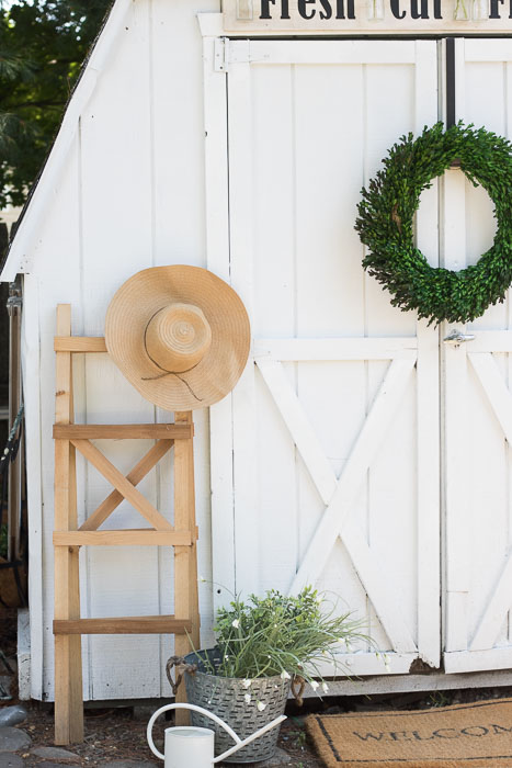 cute white shed makeover
